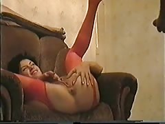 Glamorous russian babe in red stockings gets pounded on the sofa
