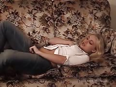 Blonde is lying on the sofa and soloing like a pornstar