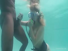 Homemade underwater blowjob by a busty young mademoiselle