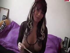 Seductive cutie in fishnet is showing off her big boobies
